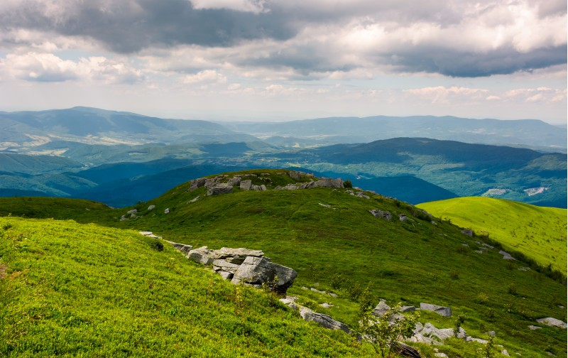 Carpathian alps with huge boulders on hillsides. beautiful summer landscape on overcast day. Location Polonina Runa, Ukraine