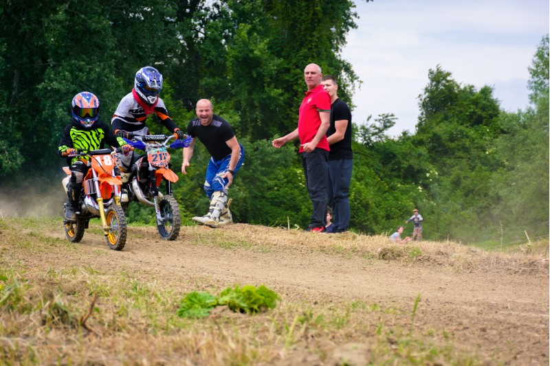 Uzhgorod, Ukraine - May 21, 2017: Extreme enduro MOTO SPORT Junior riders in the action. Parents show their support. TransCarpathian regional Motocross Championship