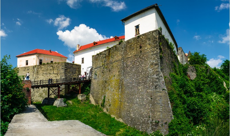 Mukachevo, Ukraine - MAY 25, 2008: Palanok Castle in summertime. Old fortification now serves as the museum and is popular tourist landmark