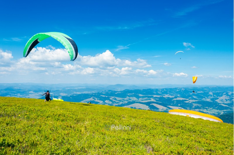 Skydiving training in mountains,  flying above the distant hills. parachute extreme sport.   absolute freedom concept. wonderful summer weather