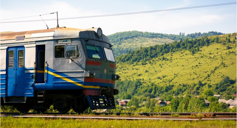 Huklyvyi, Ukraine - 20 Jul, 2017: ancient electric train arrival. moving fast in mountains