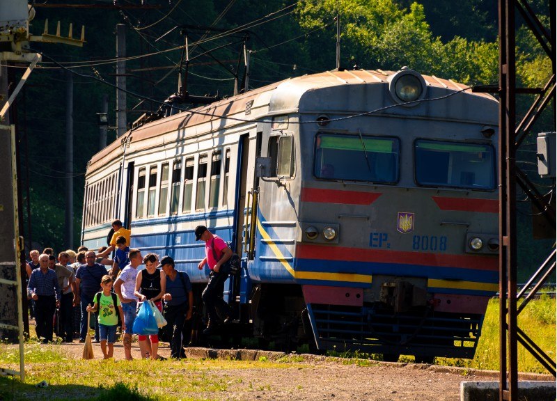 Huklyvyi, Ukraine - 20 Jul, 2017: ancient electric train arrival. people quickly take off
