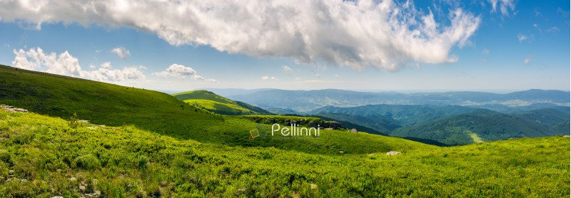 beautiful panorama of Runa mountain hills. wonderful cloudscape on a blue sky over the distant mountain range. breathtaking view of mountainous summer landscape in Carpathians