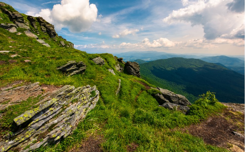 beautiful summer landscape in mountains. view from the hillside in to the valley and nearby ridge under the cloudy sky