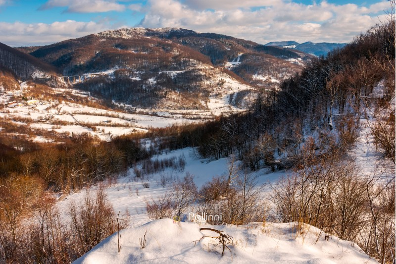 beautiful mountainous winter landscape on a sunny day. view from the top of a snowy hill
