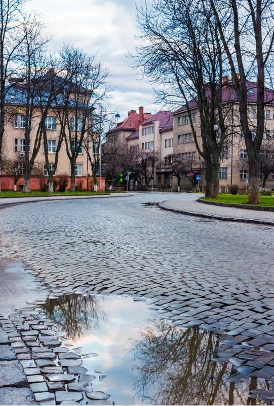 cobble street winding through old town. lovely cityscape in springtime. location Narodna square, Uzhgorod, Ukraine.
