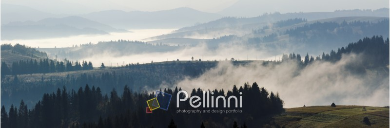 panorama of cold morning fog in hot sunrise in the mountains in the morning