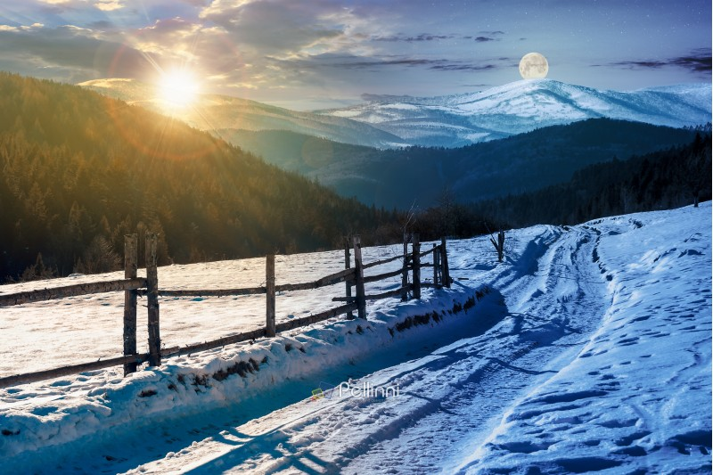 time change concept. country road in to the winter mountains. wooden fence along the road. composite image