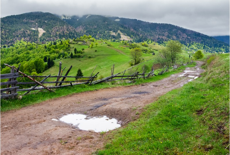 country road through rural area in mountains. beautiful landscape on a cloudy day in springtime