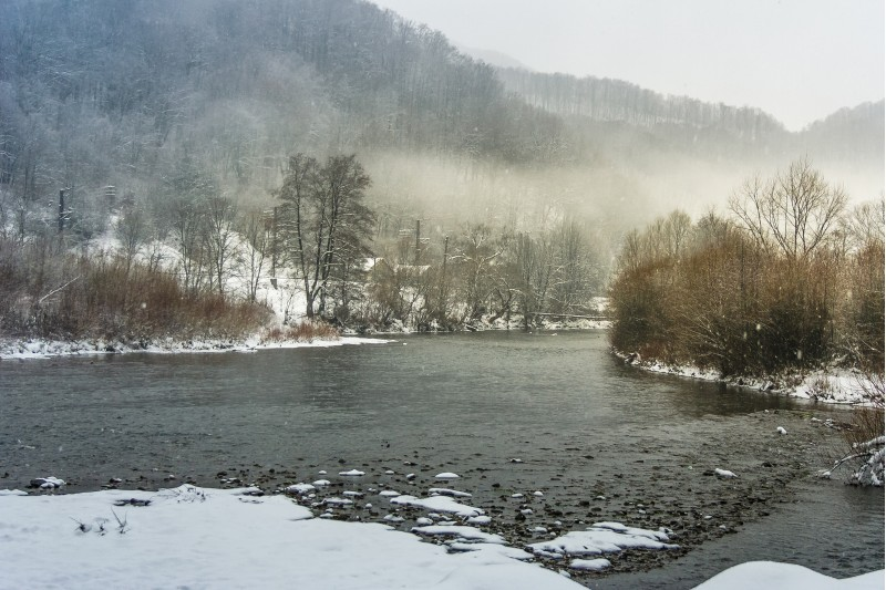 fog on the river in winter countryside. gloomy overcast weather