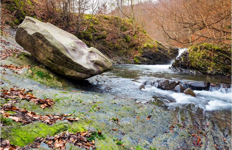 giant boulder and small cascade on the river. lovely autumn scenery of Carpathian nature. location near the village Lumshory, TransCarpathia, Ukraine