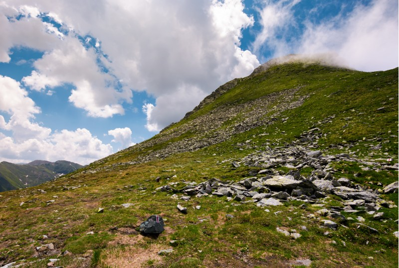 gorgeous cloudscape over the Fagaras mountains. beautiful summer landscape of Romania