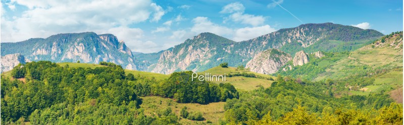 gorgeous panorama of countryside in springtime. beautiful landscape of romania. rural area on the near hills. distant ridge with rocks, cliffs and gorge. wonderful sunny forenoon