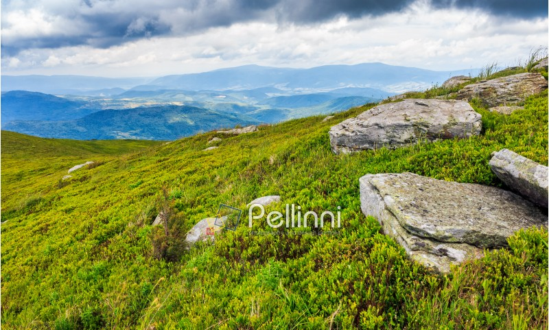 high mountain idyllic landscape. grassy meadow with boulders on hillside. beautiful nature.