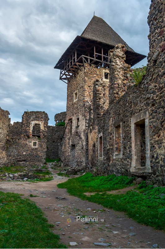 inner yard and tower of Nevytsky castle. ruins of medieval fortress, popular tourist destination of TransCarpathia