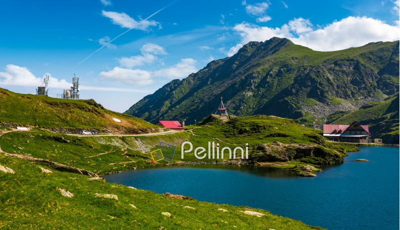 Transfagarasan road, Romania - Jun 26, 2017: lake Balea in Fagaras mountains on a bright sunny day. amazing summer landscape of one of the most visited landmarks in Romania