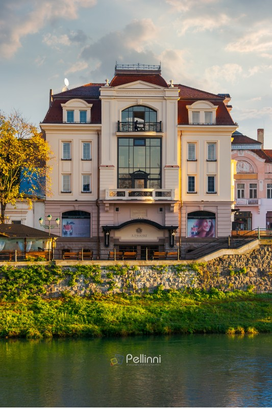 Uzhgorod, Ukraine - Nov 10, 2012: modern architecture of the old town on the bank of river Uzh at sunrise