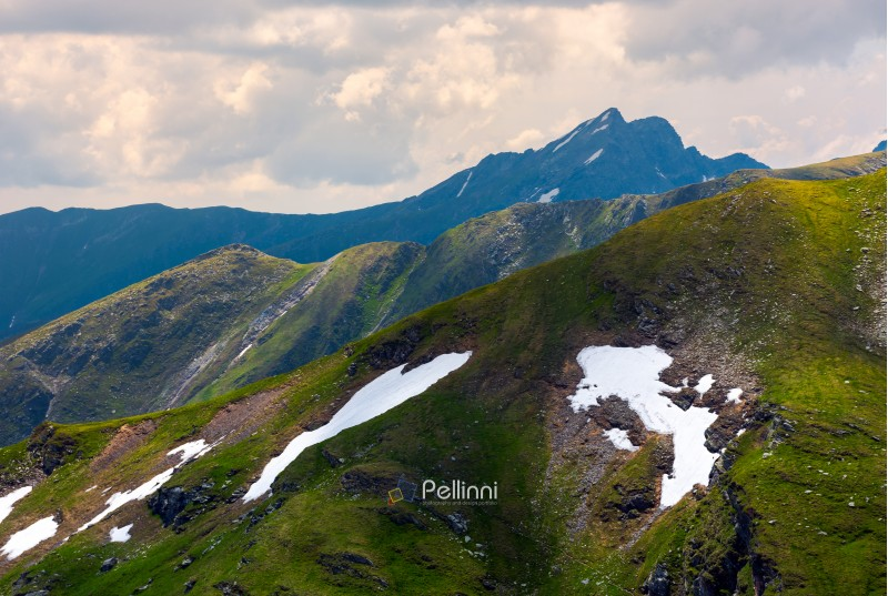 mountain peak behind the peaks. lovely scenery of Fagaras mountains on a cloudy summer day