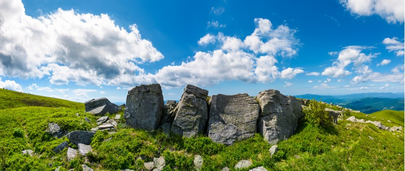 mountainous panorama with boulders on hillside. beautiful summer landscape in fine weather under the lovely cloudscape
