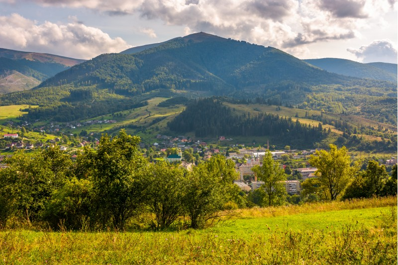 outskirts of Carpathian town Volovets. lovely countryside scenery in mountainous area with forested hills and cloudy sky