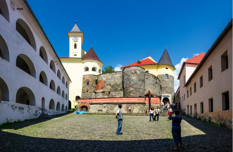 Mukachevo, Ukraine - MAY 25, 2008: panorama of Palanok Castle courtyard with clock tower. Old fortification now serves as the museum and is popular tourist landmark