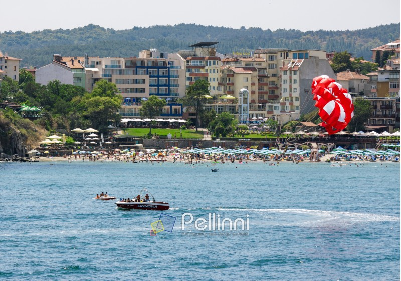 SOZOPOL - AUGUST 11: Parasailing over the sea beac  on August 11, 2015 in Sozopol, Bulgaria.  Parachute summer water; sport