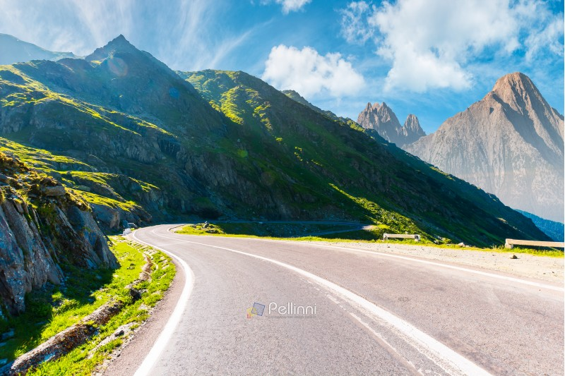 road in mountains with rocky ridge in the distance. composite image. travel by car concept