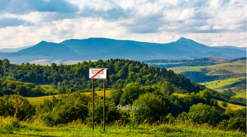 road sign on the hillside. mountain ridge  with Pikui peak in the distance. Carpathian travel destination concept. location Volovets, TransCarpathia, Ukraine