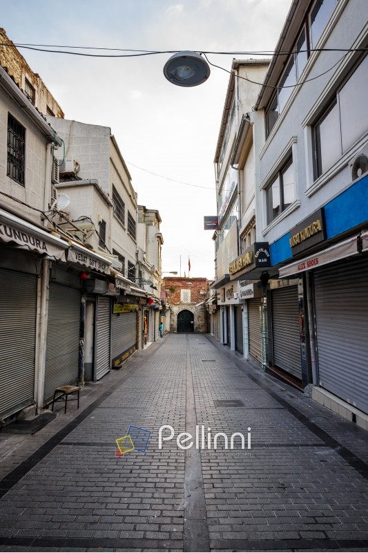 ISTANBUL - AUGUST 18: Street to Grand Bazaar August 18, 2015 in Istanbul. One of Street that leeds to Drand Bazar at sunrise before entrance