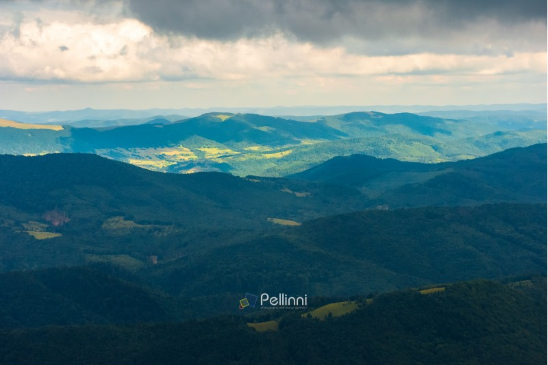 summer mountain scenery on an overcast day. distant ridge beneath in sunlight. beautiful landscape of carpathians