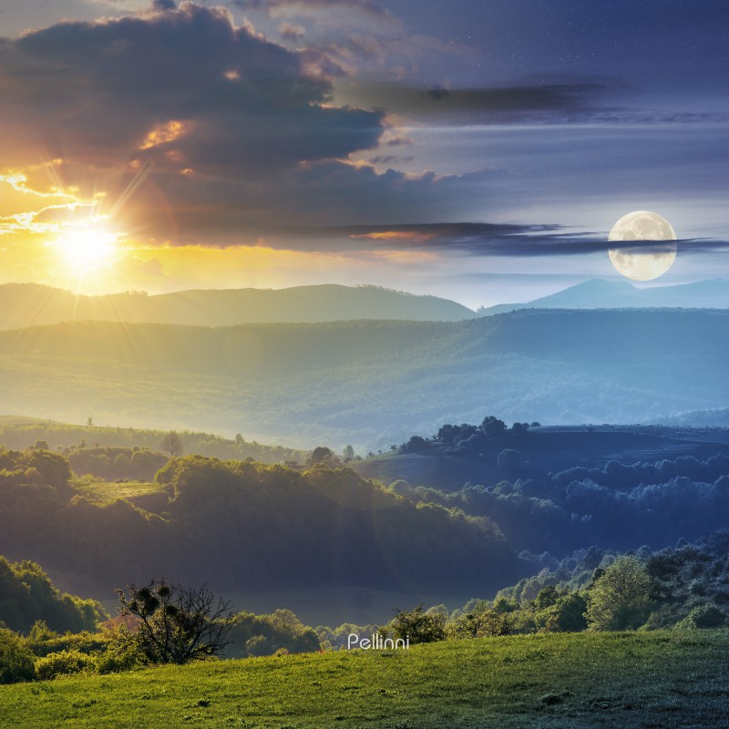 day and night time change concept above romania countryside with green rolling hills beneath a moon and sun. agricultural grassy field. mountain ridge in the distance. cloudy sky.