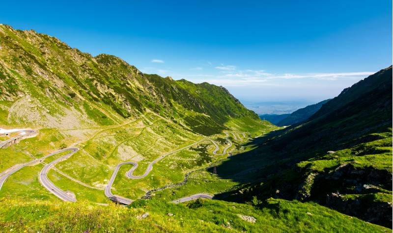 transfagarasan road in mountains of Romania. gorgeous view of the landscape from the edge of a hill. serpentine road with lots of turnarounds is winding down the valley