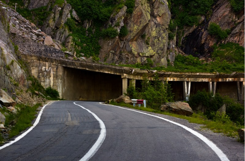 tunnel on Transfagarasan road of Romania. dangerous transportation scenery among the rocky cliffs in high Carpathian mountains in summer morning.