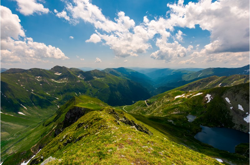 view from Saua Vaiuga in to the Valley of Fagaras. beautiful summer landscape of Southern Carpathian mountains, Romania