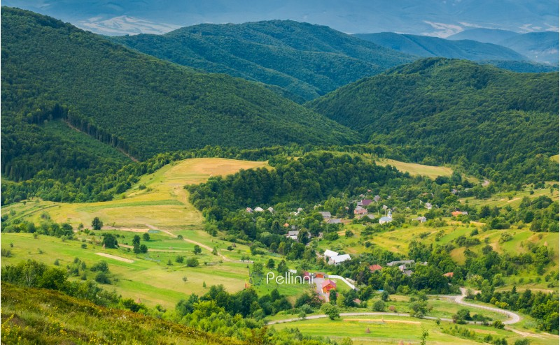 village in the valley. view from the top of a hill. beautiful summer scenery in mountains