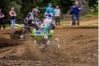 ATV Rider in the action. Off-road extreme cornering in dust. TransCarpathian regional Motocross Championship