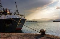 Boats docked to a mooring bollard in the  port of Bulgarian town Sozopol at sunset