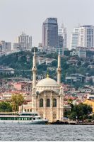 ISTANBUL, TURKEY - AUGUST 18, 2015: Ortakoy Mosque infront of the cityscape, view from the other side of Bosphorus in Istanbul
