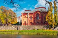 Uzhgorod, Ukraine - NOV 10, 2012: Philharmonic Orchestra Concert Hall on the bank of the river Uzh in autumn. former building of synagogue is a popular tourist attraction. beautiful sunny weather