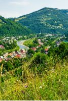 Rakhiv town in summer view from the hill. beautiful scenery in Carpathian mountains. Tisza river winds through the valley