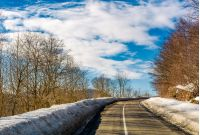 asphalt mountain road in winter. beautiful sunny day