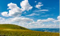 beautiful cloudscape over the mountain meadow. beautiful mountainous landscape with gorgeous sky in summer