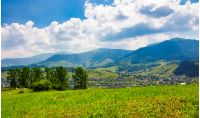 beautiful countryside of TransCarpathian town Volovets. spectacular early autumn scenery in mountains at sunrise