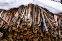 snow covered chopped firewood background