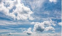 cloudy dynamic formation on a blue summer sky. dramatic weather background with beautiful cloud arrangement