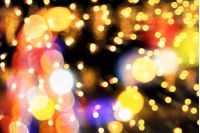 composite new yer background. abstract christmas tree with lights. defocused image with zoom technique