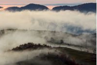 fog above the rural hills at dawn. gorgeous nature autumnal background in mountain