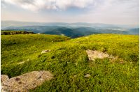 grassy meadow on top of a hill. beautiful summer scenery in mountains