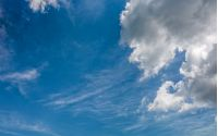 grey cloud on a blue summer sky. dramatic weather background with dynamic cloud arrangement