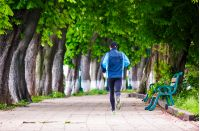 man having a morning run on alley of Kiev embankment in Uzhgorod. lovely chestnut alley in summertime